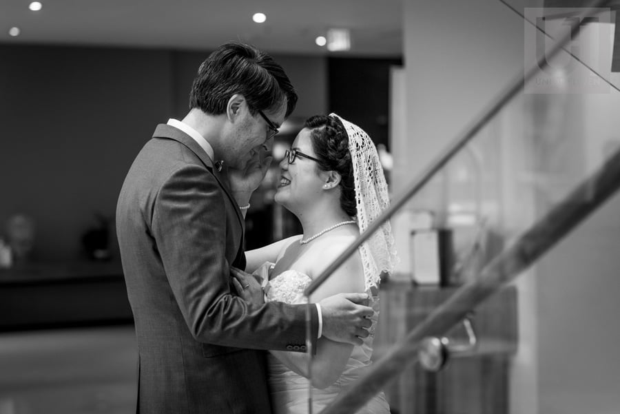 Bride and groom smiling at each other in staircase at Delta Hotel Ottawa