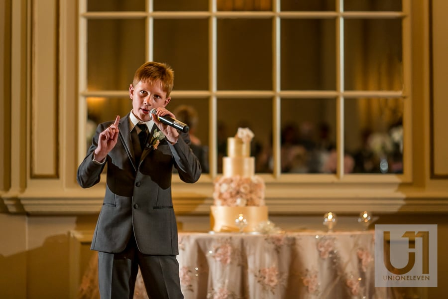 child singing at a wedding reception