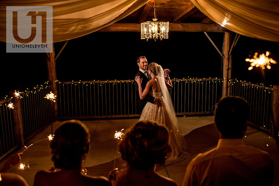bride and groom have their first dance underneath a gazebo during the reception at a le belvedere wedding in wakefield