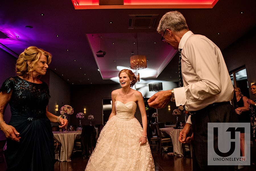 bride dancing with parents at a le belvedere wedding in wakefield