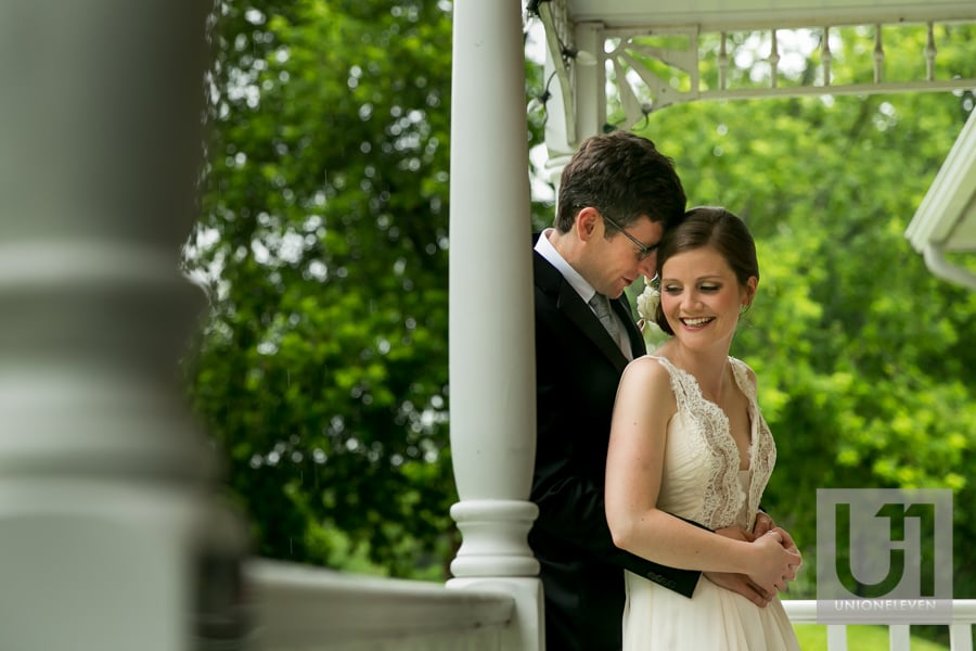 bride and groom portrait on a porch