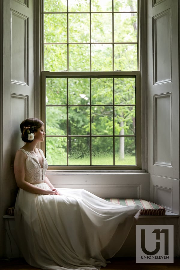 bride in a window on a rainy day
