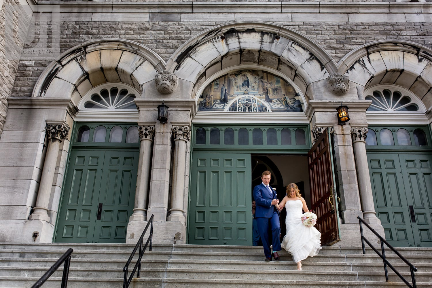 bride and groom exiting Paroisse St-François d'Assise in Ottawa after getting married