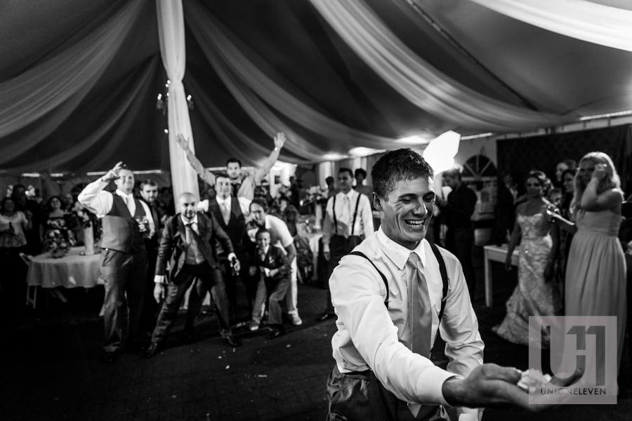 groom throwing the garter belt