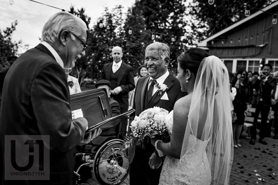 father of the bride handing off daughter at wedding ceremony in Ottawa