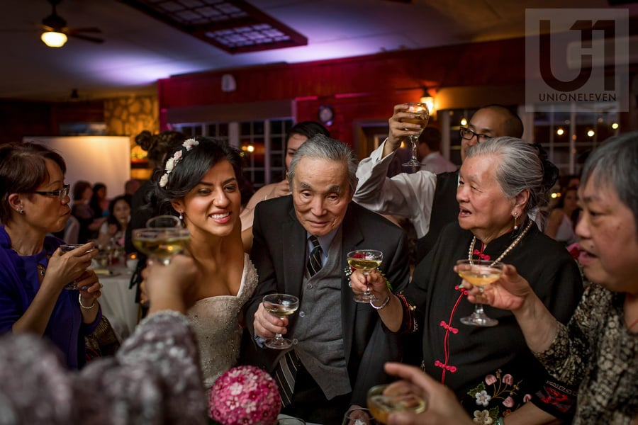 bride toasting with groom's grandparents and relatives during wedding reception at Strathmere in Ottawa