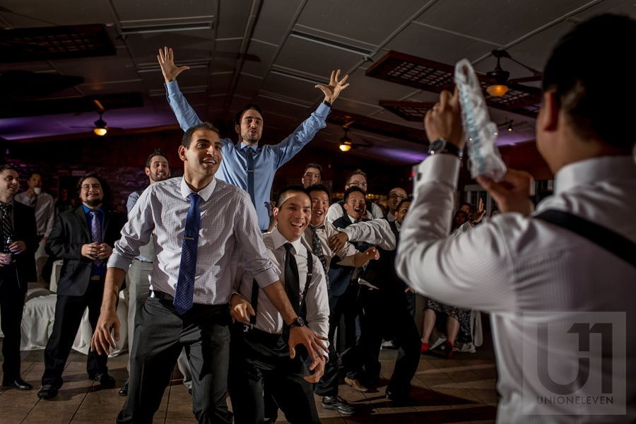 groomsmen and male guests awaiting the garter toss from the groom at Strathmere wedding