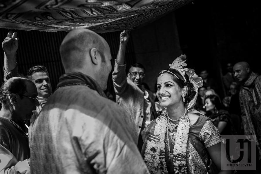 bride looking at groom adoringly during Hindu wedding ceremony