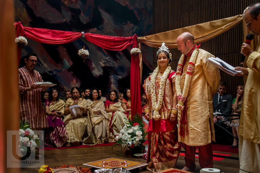 bride and groom standing during traditional Hindu wedding ceremony at the National Arts Centre in Ottawa