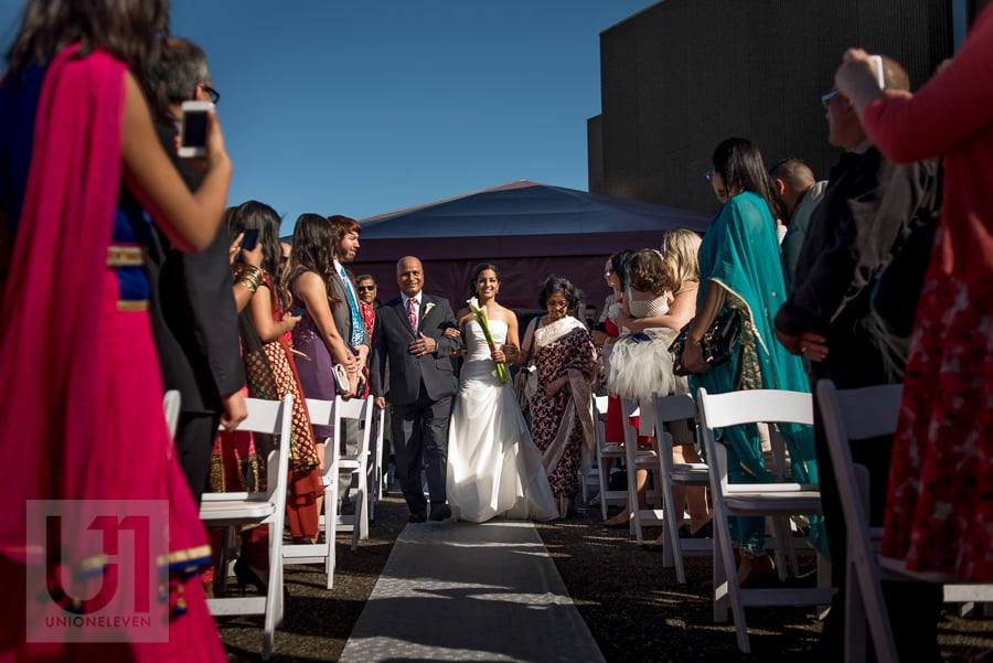 bride being walked down the aisle by her father, during rooftop ceremony at the National Arts Centre in Ottawa