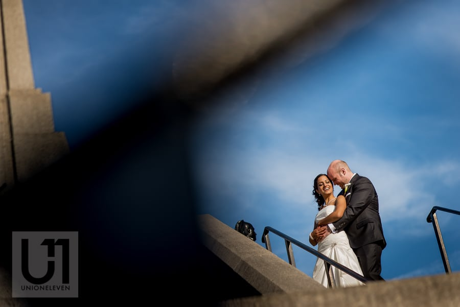 portrait of groom holding bride from behind in downtown Ottawa