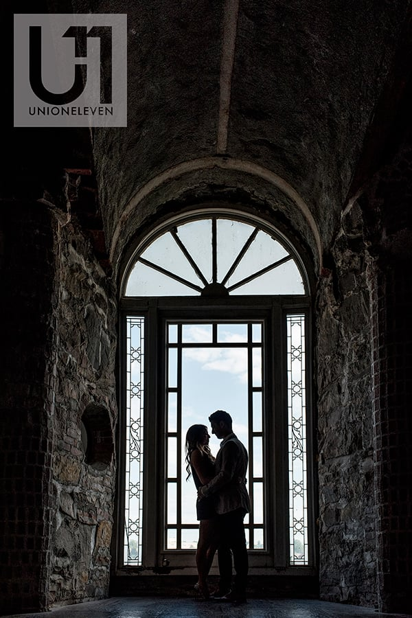couple photographed inside boldt castle for an engagement shoot