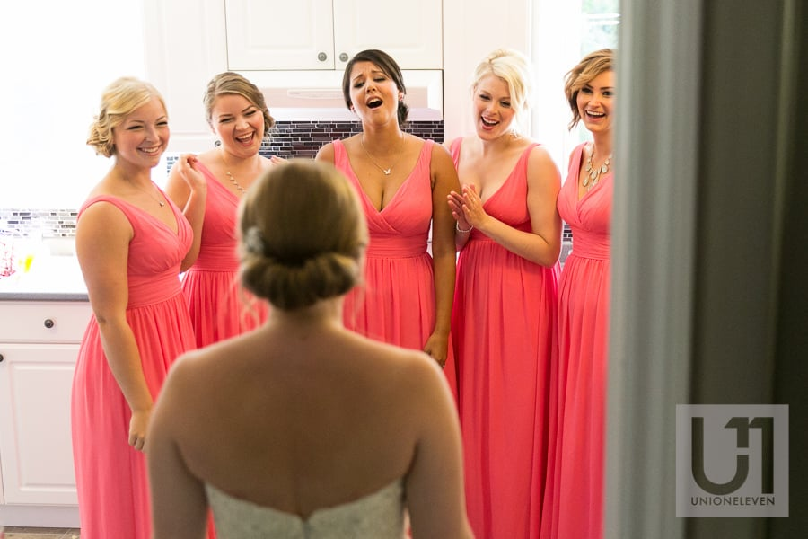 bridesmaids seeing the bride in her dress for the first time