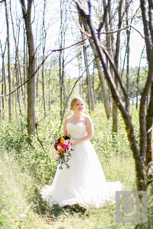 natural light bridal photograph in the woods