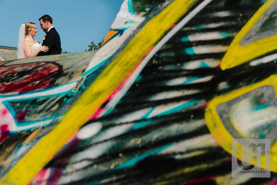 bride and groom photograph in a skatepark with graphiti