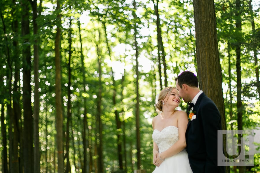 bride and groom photograph in the forest