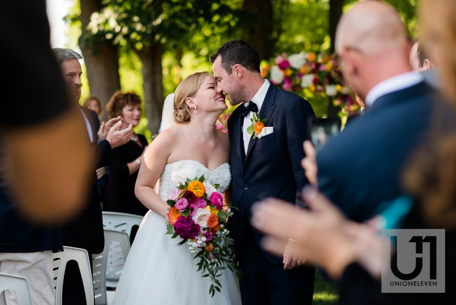 bride and groom's first kiss at cedarhill golf and country club
