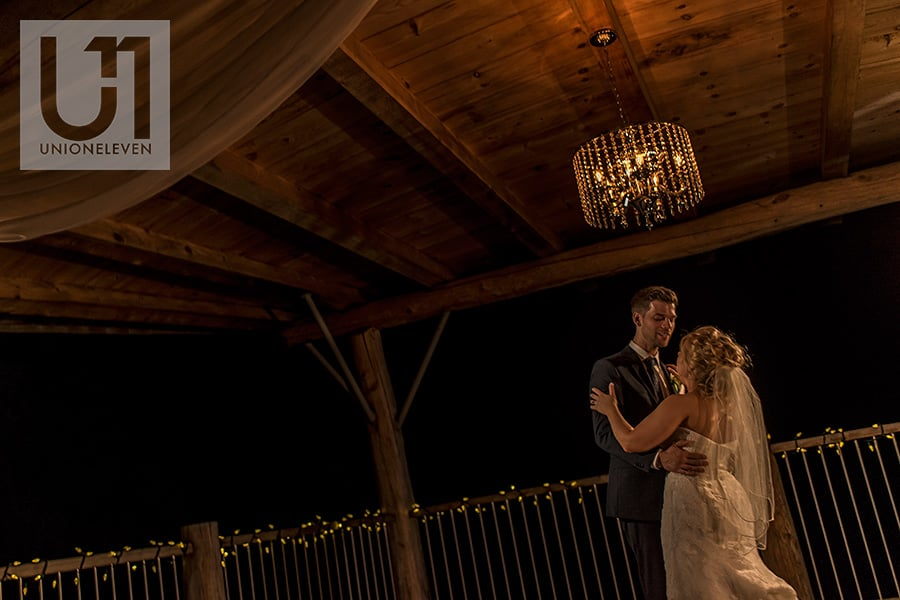 bride and groom first dance under gazebo at night at a le belvedere wedding