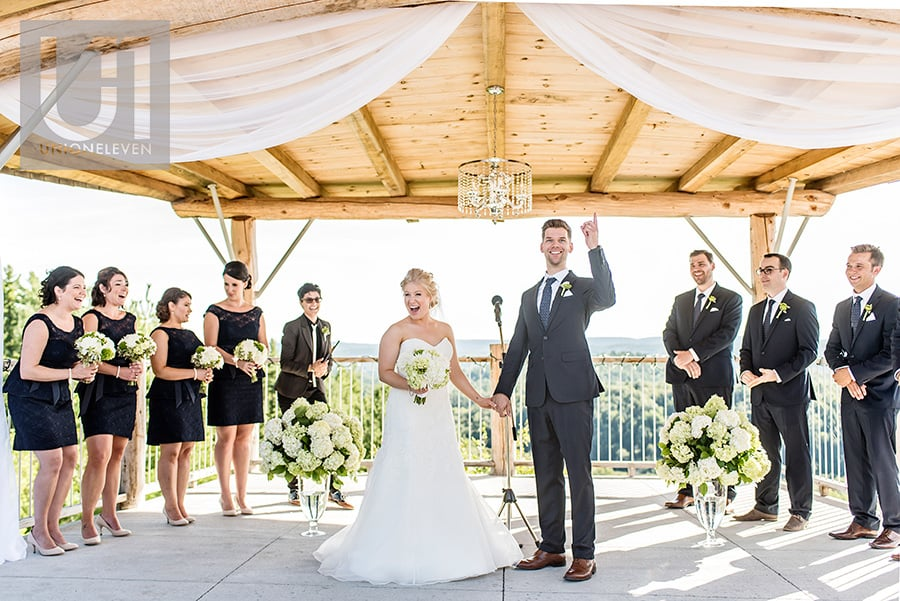 bride and groom reaction to being announced as husband and wife at a le belvedere wedding