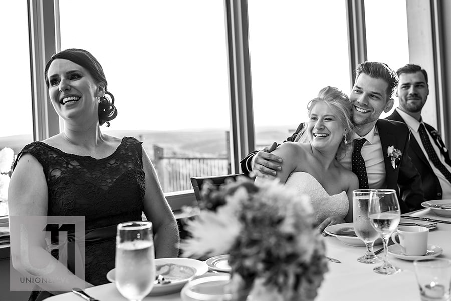 bride and groom reaction to best man speech at a le belvedere wedding