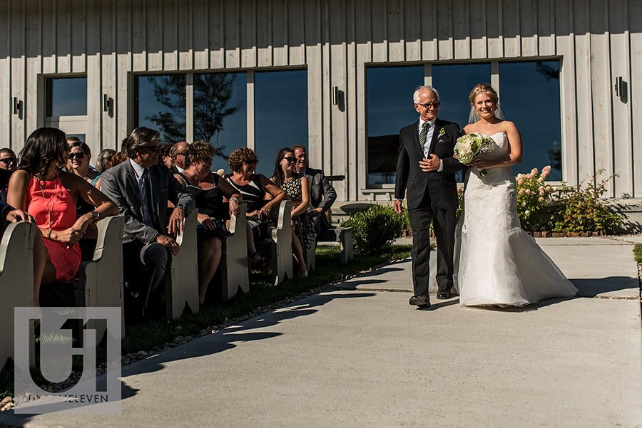 bride and her father walking down aisle at a le belvedere wedding