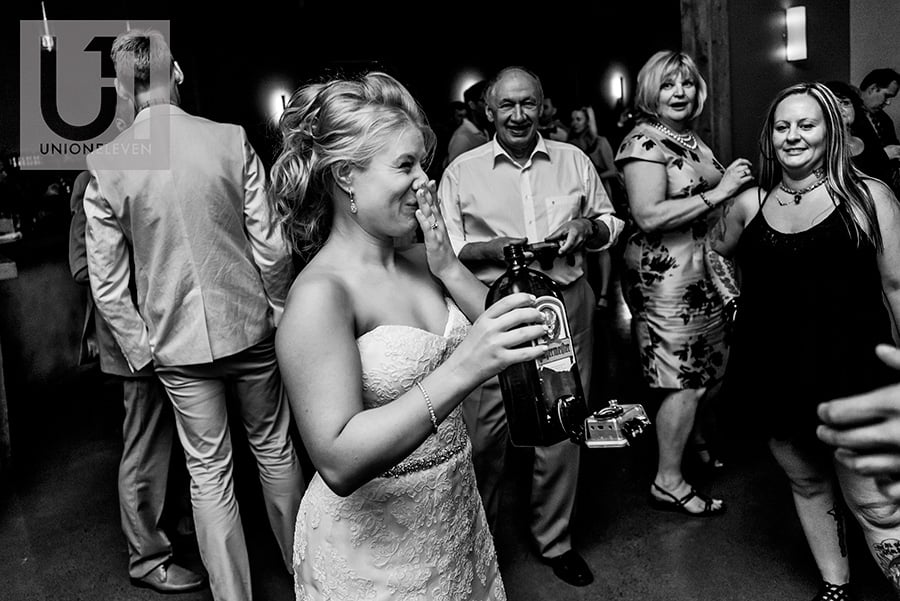 bride drinking jagermeister with go pro attached at a le belvedere wedding