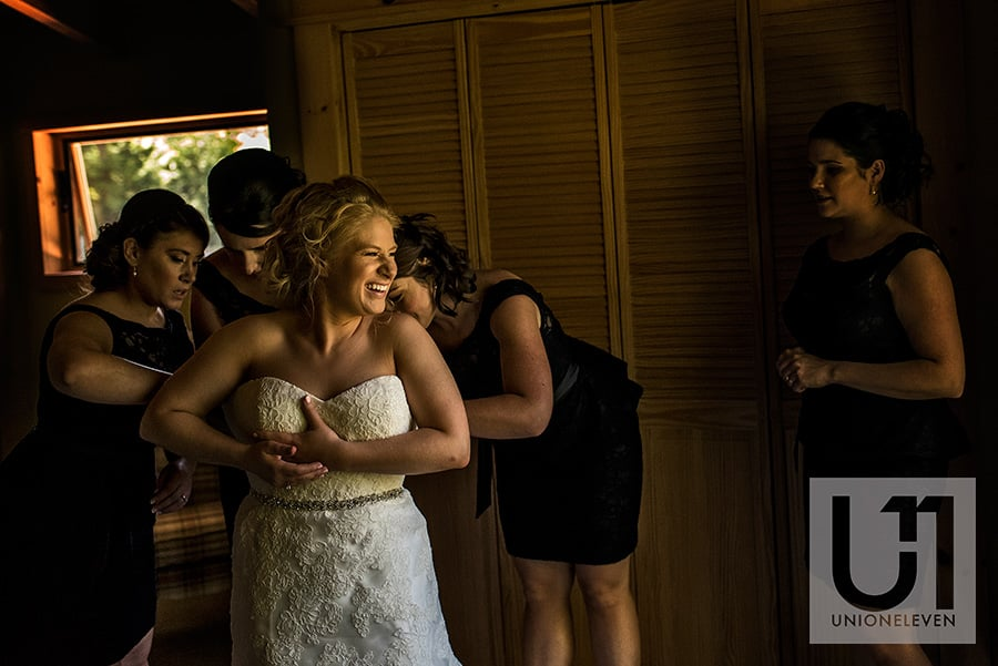 bride getting dressed le belvedere wedding