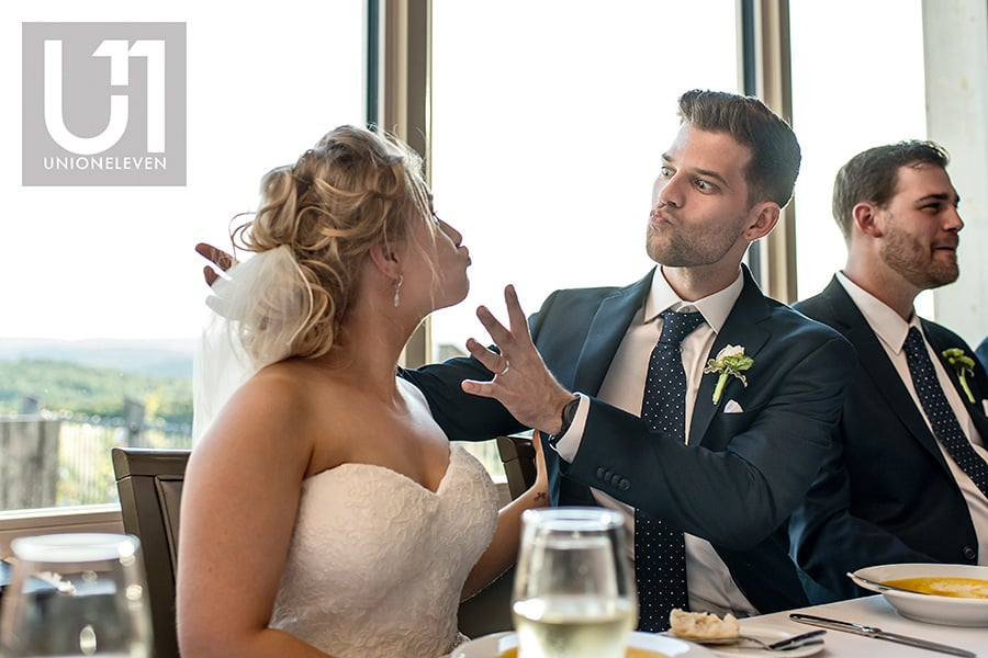 bride groom funny face during kissing game at a le belvedere wedding