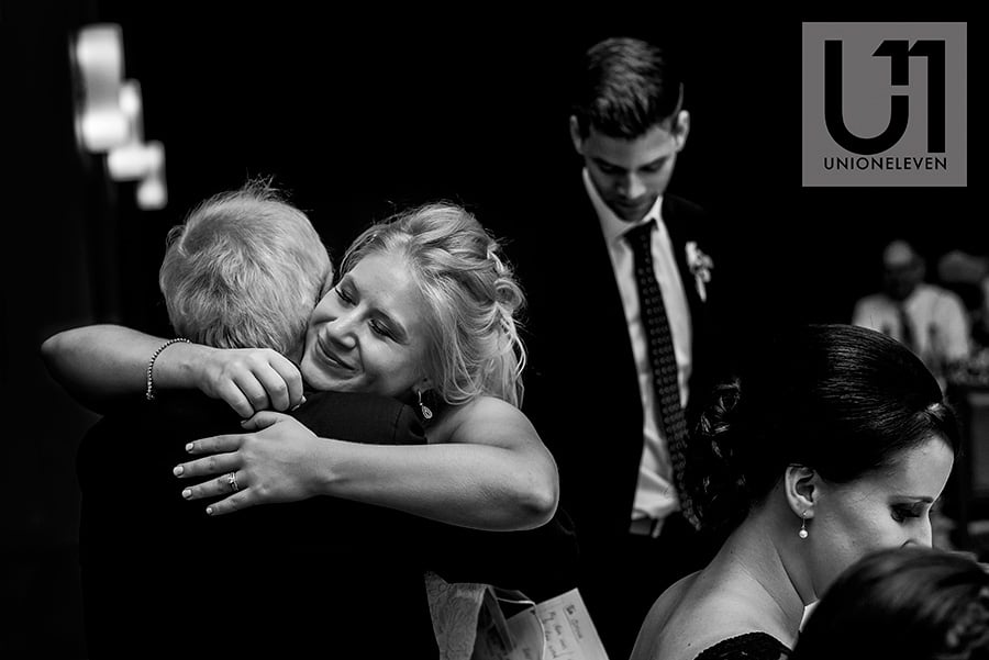 bride hugging father after speech at a le belvedere wedding