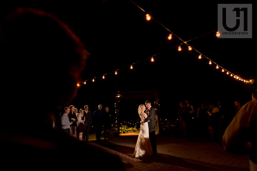 bride and groom sharing a first dance under string of lights at Strathmere in Ottawa
