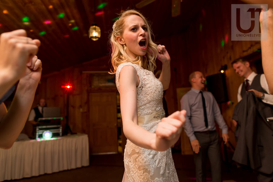 bride dancing with a funny expression on her face at wedding reception at Strathmere in Ottawa