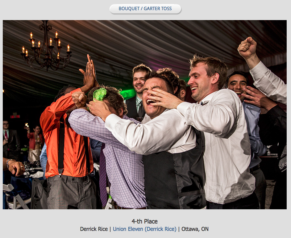 a bunch of guys grappling trying to catch the brides garter during the garter toss
