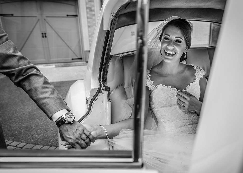 father helps bride into vintage rolls royce before a wedding at a le belvedere wedding in wakefield quebec