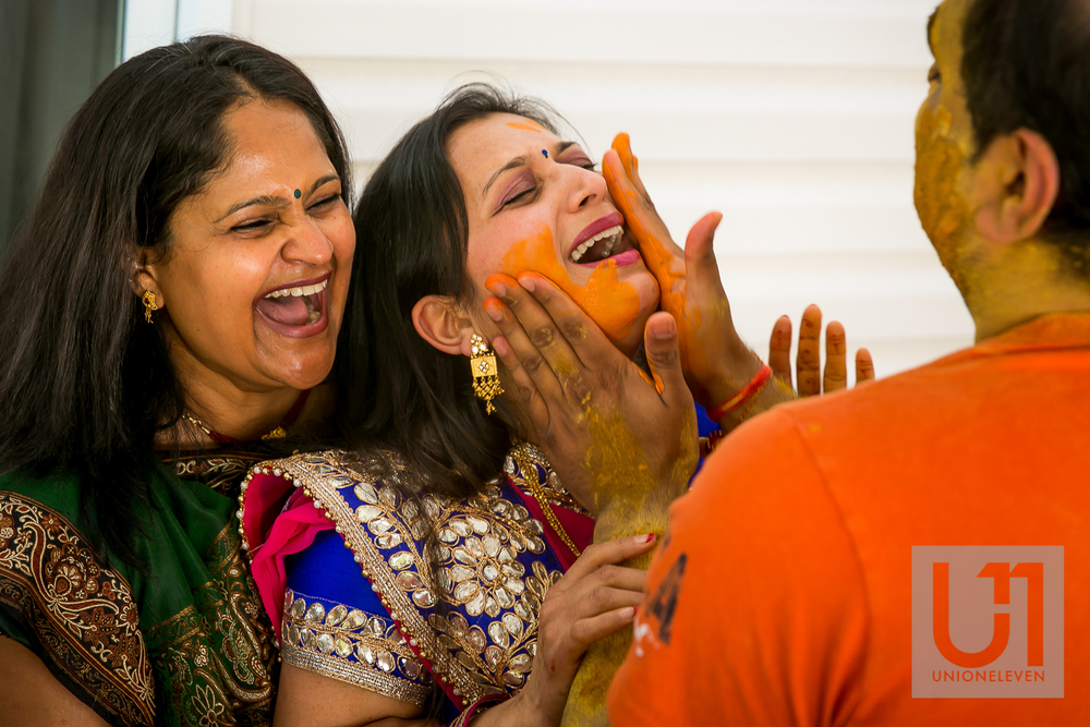 indian groom rubs pithi on his sisters face