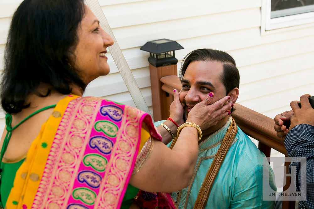 indian groom and his mother on his wedding day