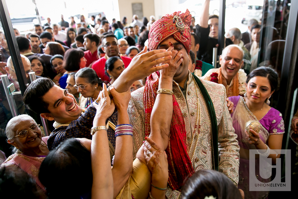 indian groom trying to get to his wedding ceremony