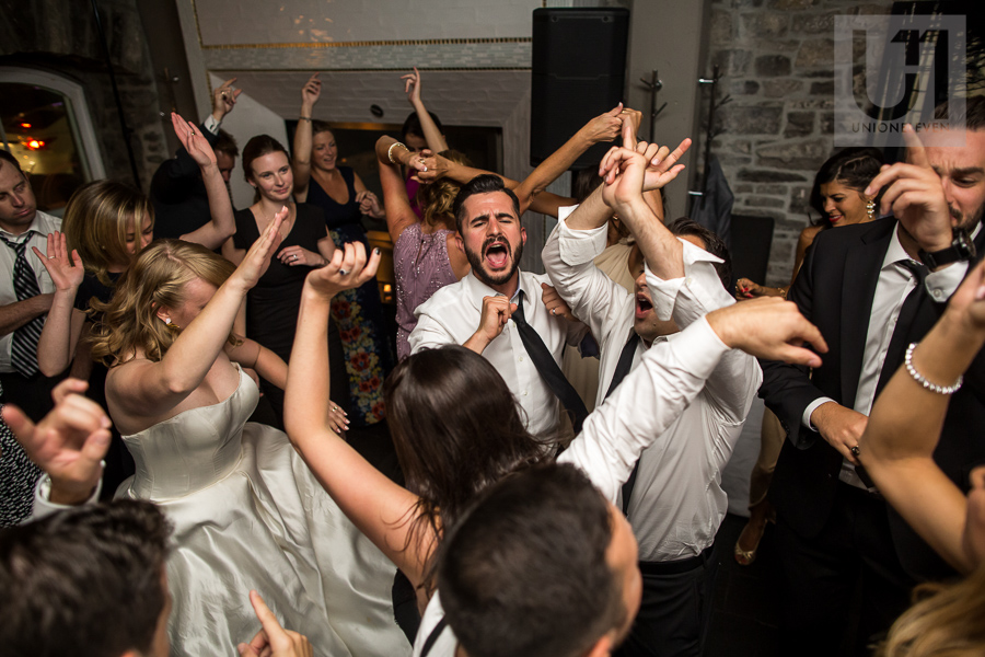 large-crowd-of-guests-dancing-during-wedding-reception-at-eighteen-restaurant-in-ottawa