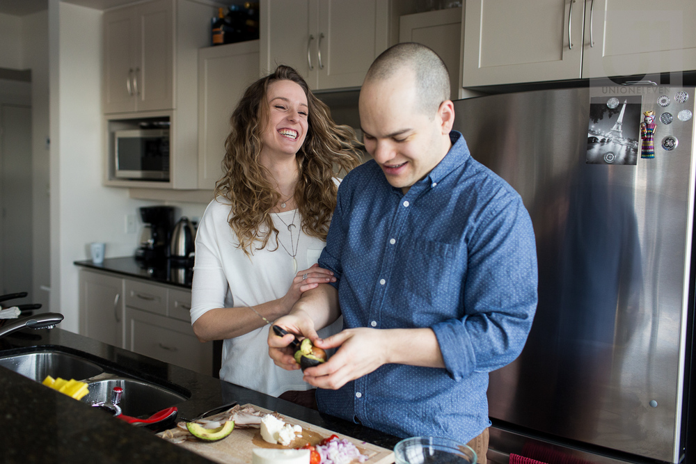 couple-laughing-in-kitchen