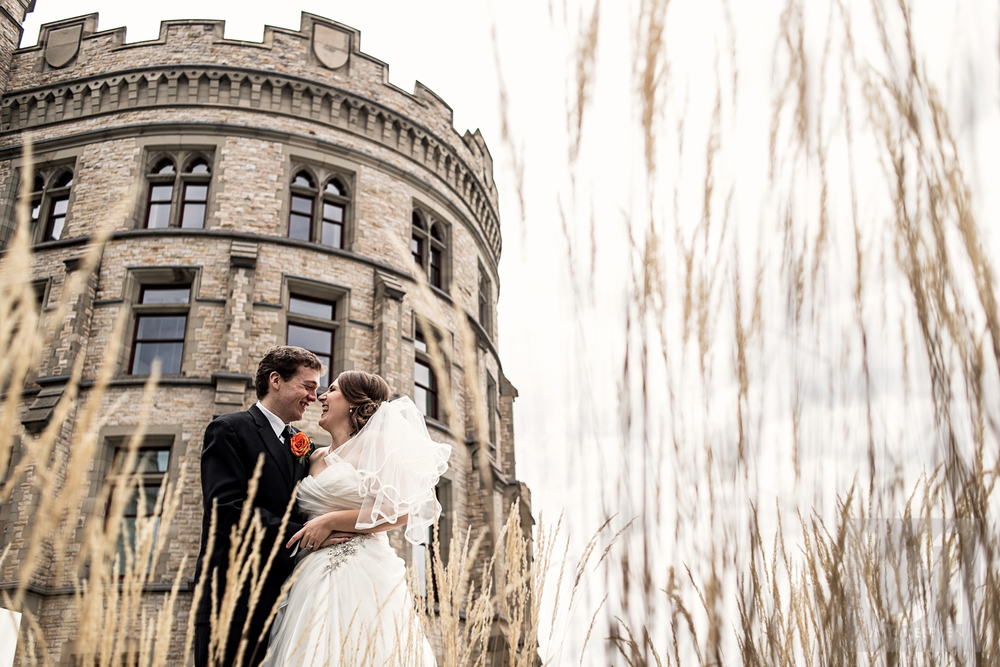An outdoor photo of the bride and groom in front of the Museum of Nature, Ottawa