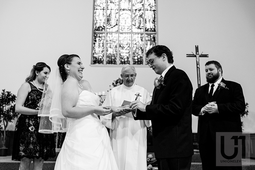 The bride and groom exchanging their wedding rings