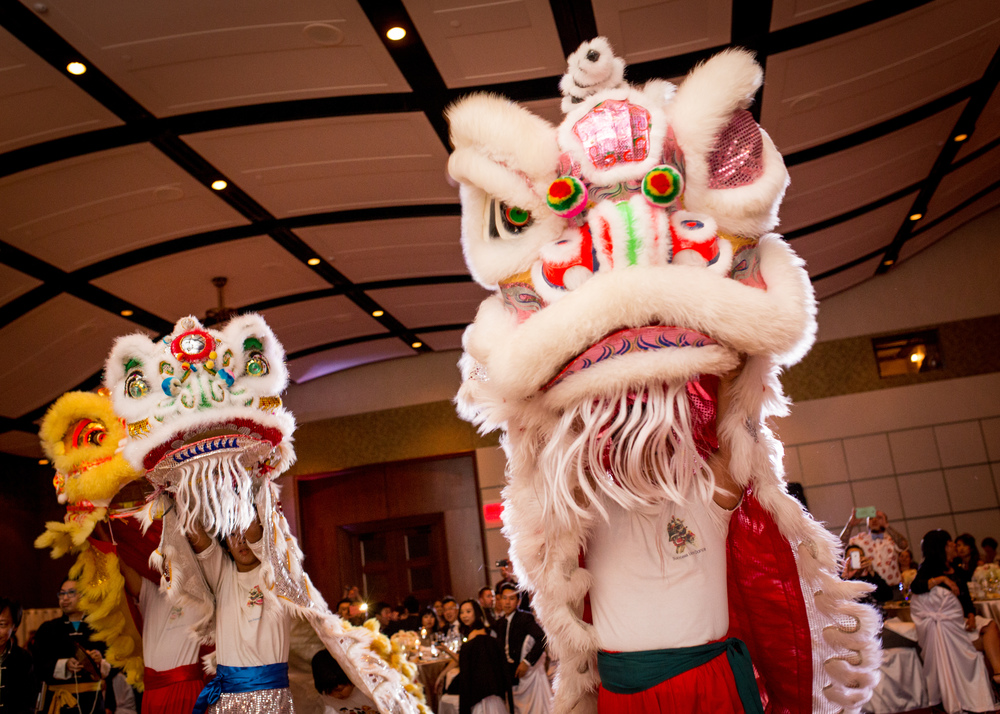 Traditional dragon dancers and the wedding reception