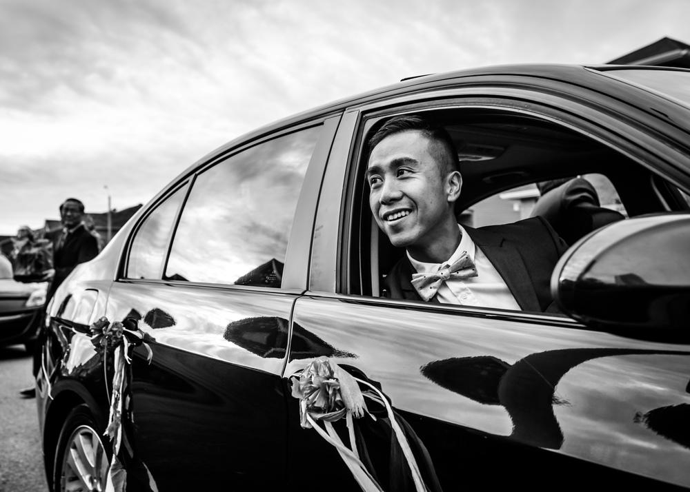Groom arriving in the car to meet his bride
