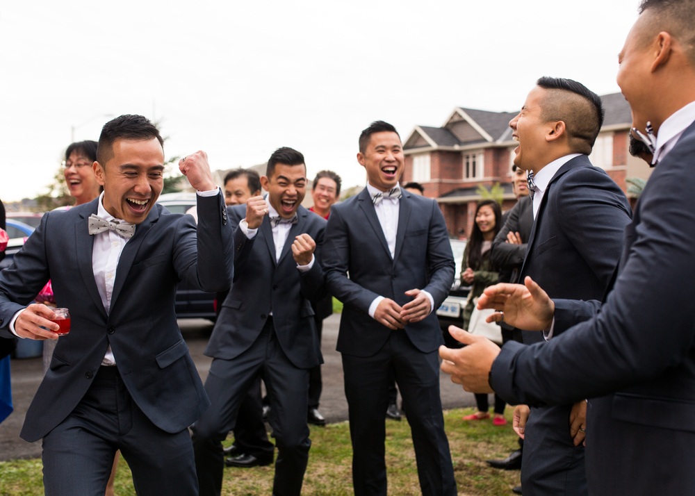 Groom and his groomsmen playing their traditional pre-ceremony games