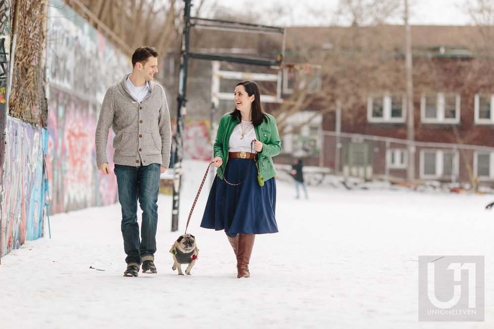 Engagement shoot with the couple walking their pug in the park