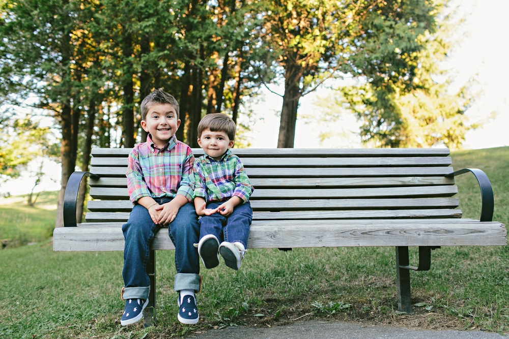 photo of brothers sitting on a bench outside in ottawa