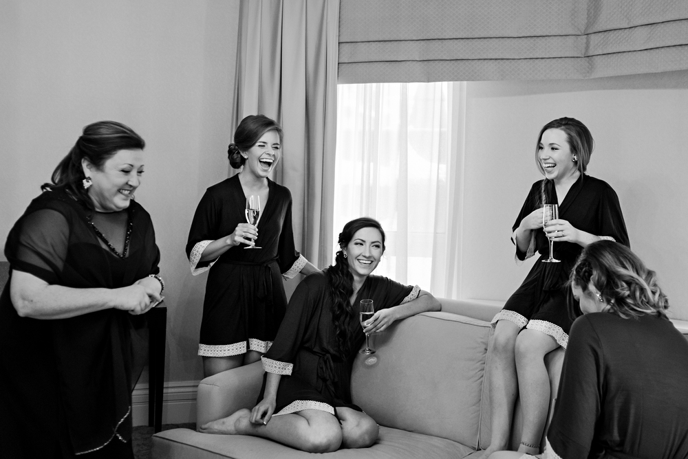 Bridesmaids having a champagne toast together