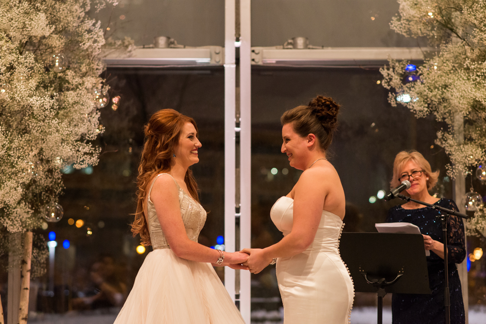 A photo of the two brides during their wedding ceremony in Quebec City