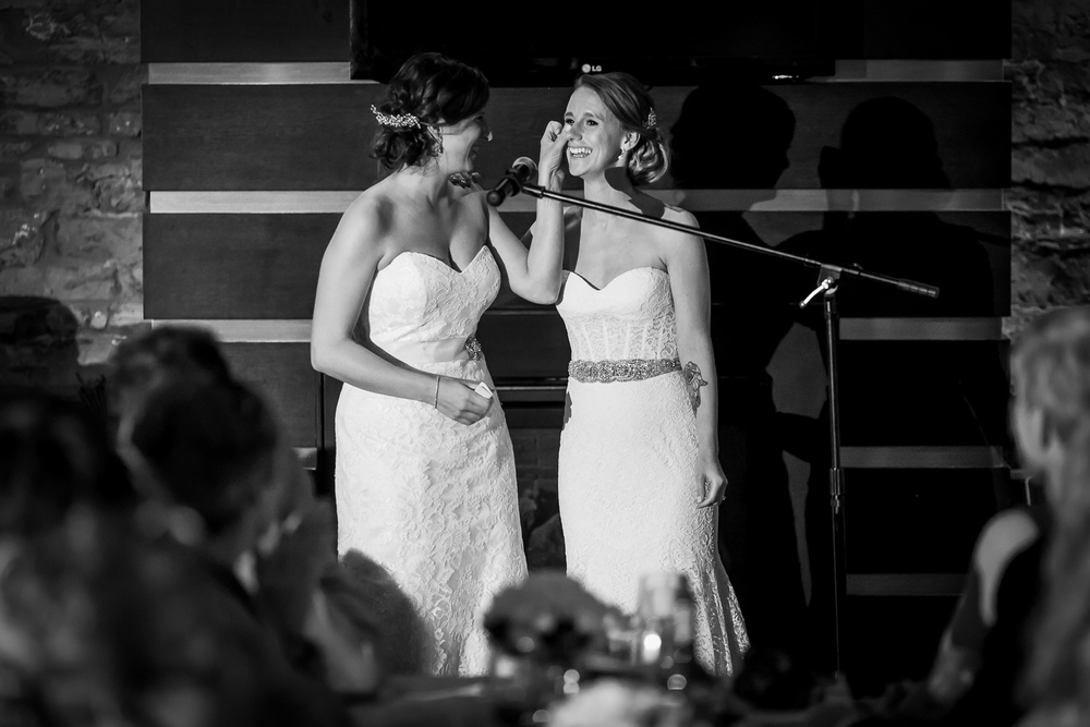 The brides giving their speech during the reception at the Mill Street Brew Pub