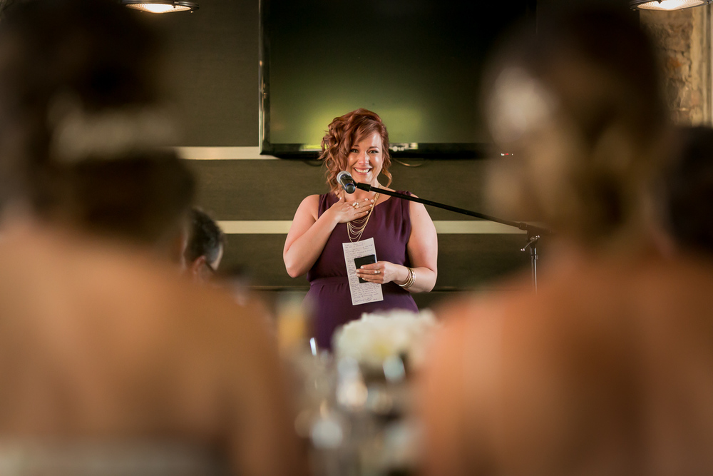 A bridesmaid giving her speech during the wedding reception