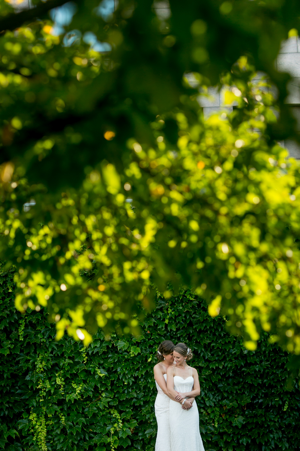 A portrait of the brides after their wedding ceremony at the Rockcliffe Pavilion
